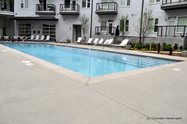 Sandscape concrete pool deck