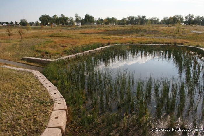 Nrel detention pond restores natural habitat with for Design of stormwater detention ponds