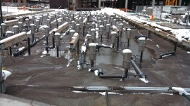 Snow covered pipes and nozzles