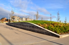 Sedimentary wall and concrete flatwork by Colorado Hardscapes
