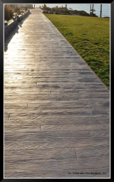 Boardwalk stamped concrete installed by TB Penick