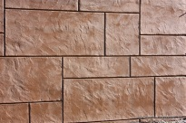 Kent Place custom colored, textured, and imprinted shotcrete wall`
