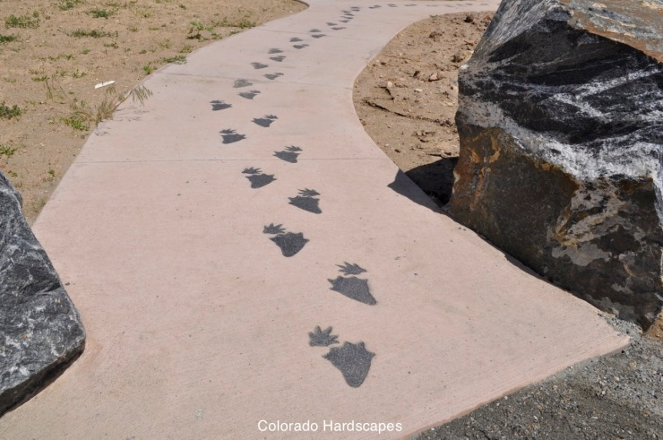Throughout the park Colorado Hardscapes sandblasted and stained various river habitat footprints
