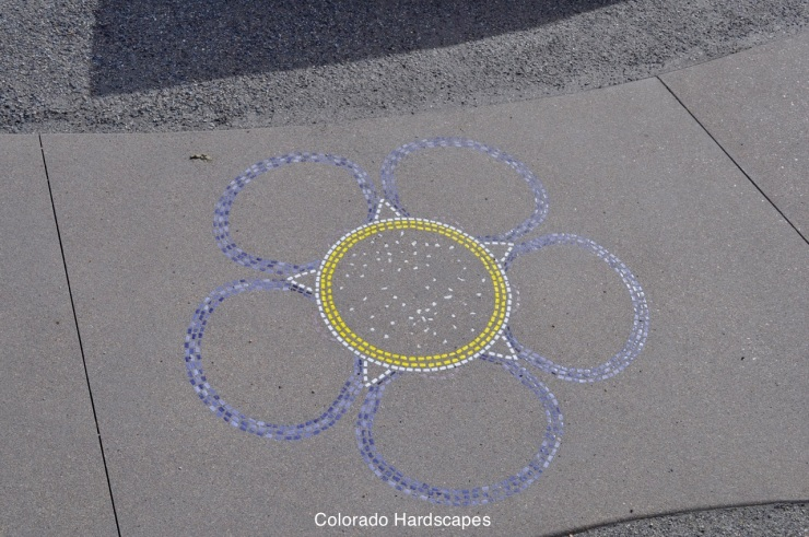 In the flower plaza, Colorado Hardscapes created 7 Forget-me-not flowers into concrete with LithoMosaics
