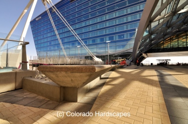 Custom polished concrete bench installed by Colorado Hardscapes