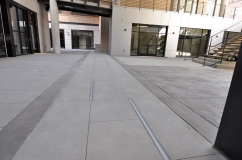 Wencel Building in Boulder featuring Sandscape Refined, broom finish concrete and Bomanite stamped concrete by Colorado Hardscapes